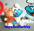 20205 - Baby Smurf with Teddy